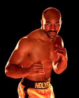 "Holyfield (via <a href=""http://www.bet.com/News/Photos/NewsFlipBookBringThatWeekBack0613.htm?i=7"">BET</a>)"