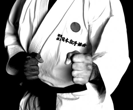 "Karate Dude! (Via <a href=""http://commons.wikimedia.org/wiki/File:JKA_Karate_Kamae_Knuckles.jpg"">Wikimedia</a>.)"
